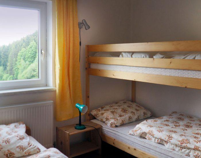 Stockbett im ersten Schlafzimmer der Ferienwohnung Gutenbrunner